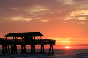 A photograph of a beautiful sunrise at Tybee Island in Savannah. Tybee Island is an island and city in Chatham County, Georgia, near the city of Savannah.
